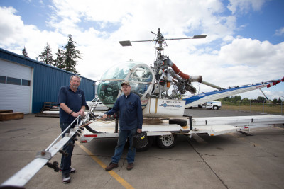 Western Helicopter president Rick Krohn, left, with Director of Maintenance Karson Branham. Western Helicopter owns eight helicopters (ranging in cost from $300,000 to $1.2 million) that costs about $1,200 per hour to fly. Branham is in charge of monitoring and repairing the multitude of parts and pieces of the aircraft that are regulated by the FAA. He estimates the helicopters take about an hour of maintenance per hour of flight.